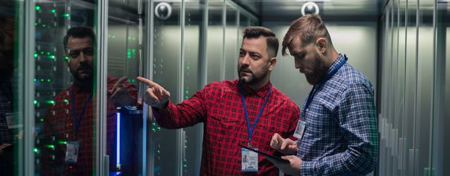two guys standing in server room